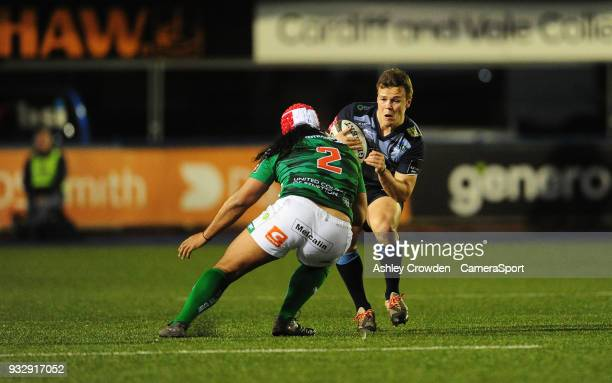 Cardiff Blues' Jarrod Evans is tackled by Bentton Rugbys Epalahame Faiva during the Guinness PRO12 Round 17 match between Cardiff Blues and Benetton...