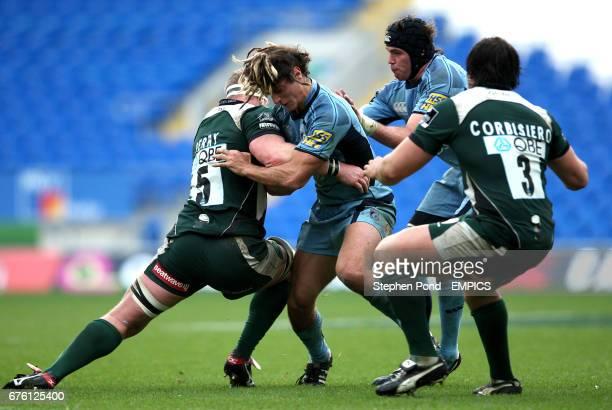 Cardiff Blues' Josh Navidi and London Irish's Andy Perry battle