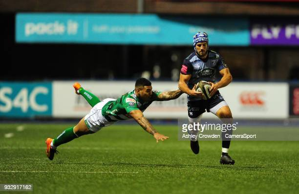 CARDIFF WALES MARCH Cardiff Blues' Matthew Morgan evades the tackle of Bentton Rugbys Monty Ioane during the Guinness PRO12 Round 17 match between...