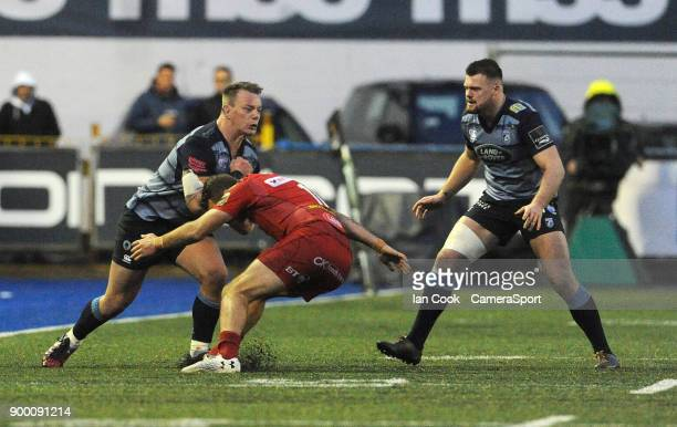 Cardiff Blues' Matthew Rees smashes into Scarlets' Paul Asquith during the Guinness Pro14 Round 12 match between Cardiff Blues and Scarlets at...