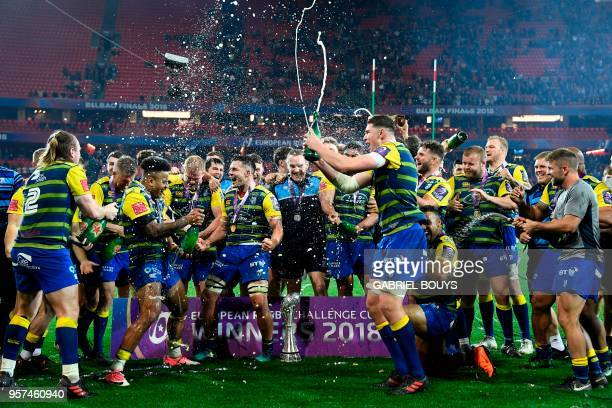 Cardiff Blues players celebrate with champagne after winning the 2018 European Challenge Cup final rugby union match against Gloucester at the San...