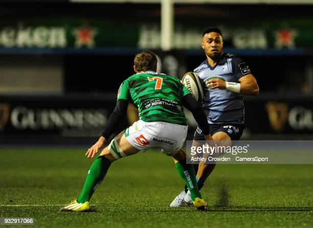Cardiff Blues' Willis Halaholo evades the tackle of Bentton Rugbys Marco Barbini during the Guinness PRO12 Round 17 match between Cardiff Blues and...