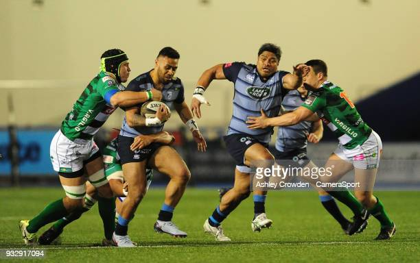 Cardiff Blues' Willis Halaholo is tackled by Bentton Rugbys Francesco Minto during the Guinness PRO12 Round 17 match between Cardiff Blues and...