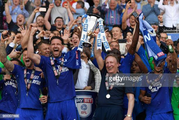 Cardiff captain Sean Morrison and manager Neil Warnock celebrate promotion to the premier league with the squad after the Sky Bet Championship match...