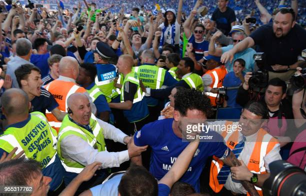 Cardiff captain Sean Morrison leaves the field congratulated by fans after the Sky Bet Championship match between Cardiff City and Reading at Cardiff...