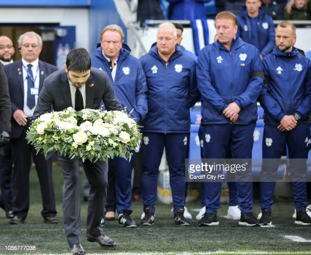 Cardiff City Chairman Vincent Tan's son lays a wreath before the Premier League match between Cardiff City and Leicester City at Cardiff City Stadium...