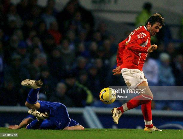 Cardiff City defender Kevin Mcnaughton lies in a crumpled heap after a challenge by Barnsley striker Martin Devaney left him with a serious injury...