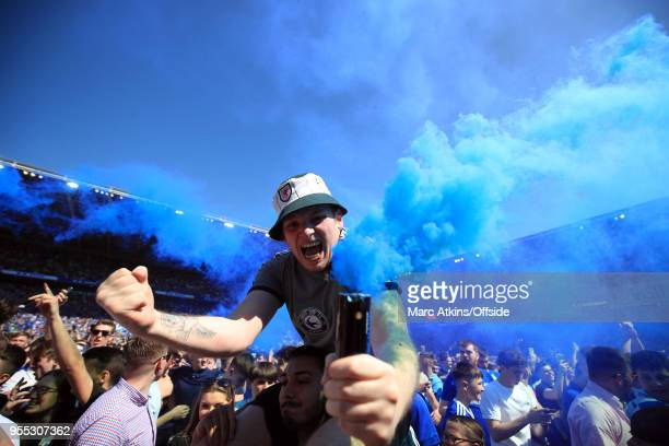 Cardiff City fan celebrates promotion holding a flare during the Sky Bet Championship match between Cardiff City and Reading at Cardiff City Stadium...
