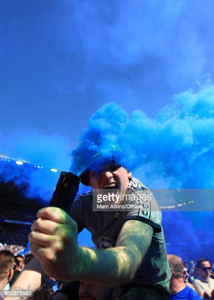 Cardiff City fan celebrates promotion holding a smoke bomb during the Sky Bet Championship match between Cardiff City and Reading at Cardiff City...