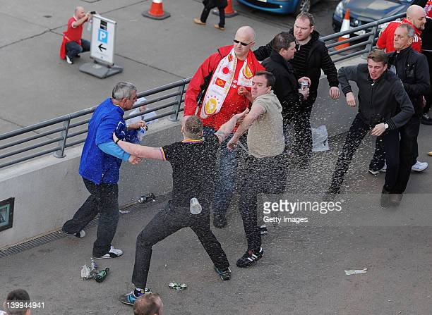Cardiff City fan clashes with Liverpool fans prior to the Carling Cup Final match between Liverpool and Cardiff City at Wembley Stadium on February...