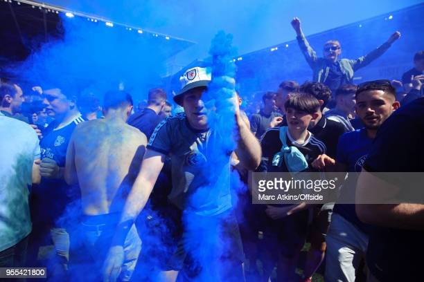 Cardiff City fan dances in celebration with a smoke bomb during the Sky Bet Championship match between Cardiff City and Reading at Cardiff City...