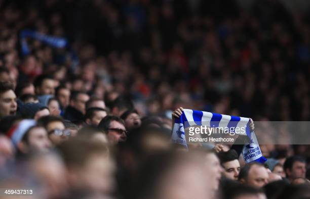 Cardiff City fan holds his scarf during the Barclays Premier League match between Cardiff City and Southampton at Cardiff City Stadium on December...