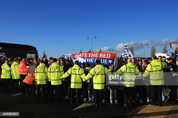 Cardiff City fans are held back by stewards outside the ground prior to the Barclays Premier League match between Cardiff City and Southampton at...
