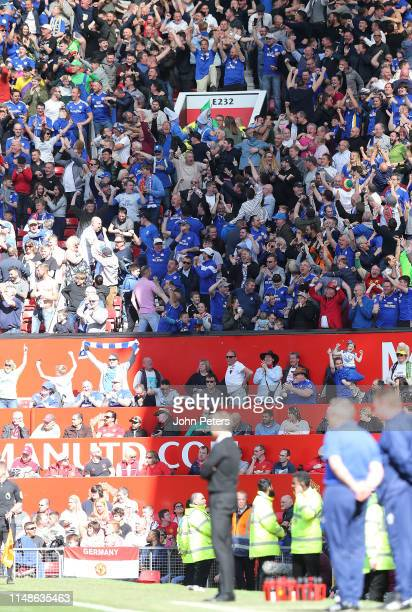 Cardiff City fans celebrate Nathaniel MendezLaing scoring their second goal during the Premier League match between Manchester United and Cardiff...