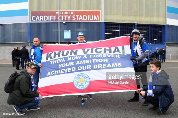 Cardiff City fans hold up a flag in memory of Vichai Srivaddhanaprabha outside the stadium prior to the Premier League match between Cardiff City and...