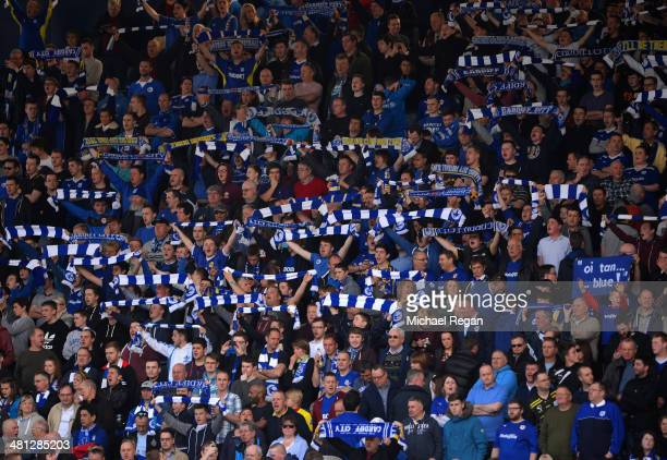 Cardiff City fans show their colours during the Barclays Premier League match between West Bromwich Albion and Cardiff City at The Hawthorns on March...