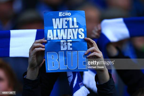 Cardiff City fans show their support for keeping the blue colours during the Barclays Premier League match between Cardiff City and Chelsea at...