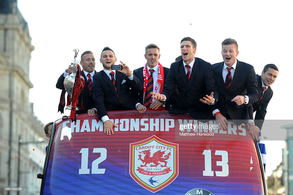 Cardiff City FC players (L-R) Craig Bellamy, Craig Conway, Craig Noone, Mark Hudson, Aron Gunnarsson and Don Cowie ride in an open top bus through the city centre during a victory parade in honour of the football club winning the npower Championship League trophy on May 05, 2013 in Cardiff, Wales.