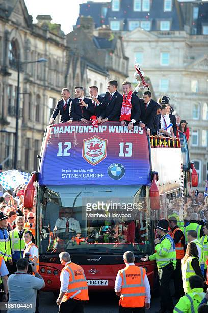 Cardiff City FC players ride in an open top bus through the city centre during a victory parade in honour of the football club winning the npower...