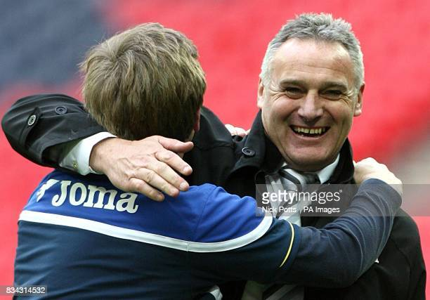 Cardiff City manager Dave Jones celebrates with coach Terry Burton after the final whistle