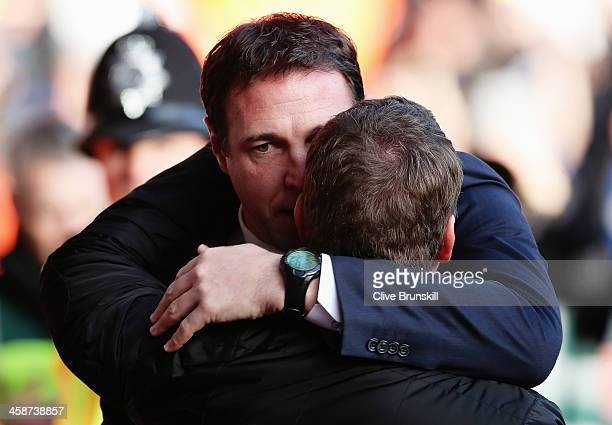 Cardiff City manager Malky Mackay is embraced by Liverpool manager Brendan Rogers before the Barclays Premier League match between Liverpool and...