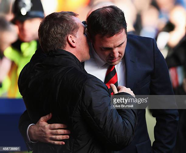 Cardiff City manager Malky Mackay talks with Liverpool manager Brendan Rogers before the Barclays Premier League match between Liverpool and Cardiff...