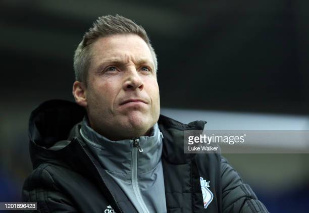 Cardiff City Manager Neil Harris looks on during the FA Cup Fourth Round match between Reading FC and Cardiff City at Madejski Stadium on January 25...