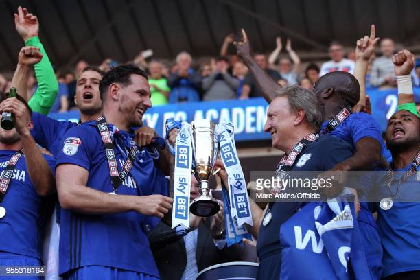 Cardiff City manager Neil Warnock and Captain Sean Morrison hold the trophy during the Sky Bet Championship match between Cardiff City and Reading at...