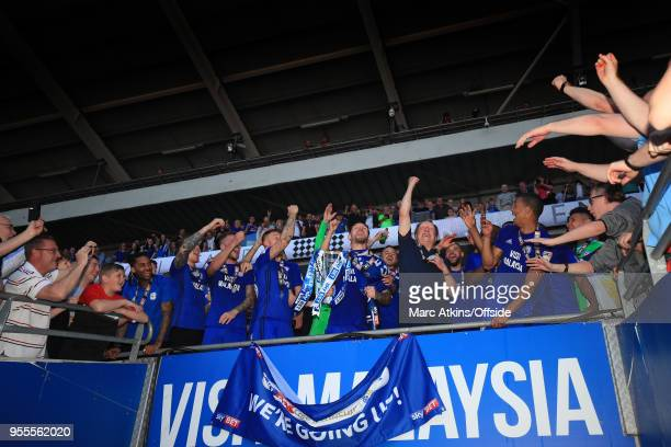 Cardiff City manager Neil Warnock and his players celebrate promotion during the Sky Bet Championship match between Cardiff City and Reading at...