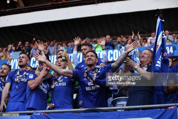 Cardiff City manager Neil Warnock celebrates alongside Captain Sean Morrison during the Sky Bet Championship match between Cardiff City and Reading...