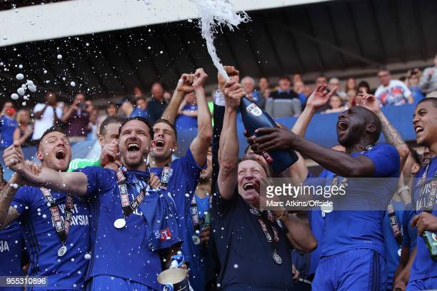 Cardiff City manager Neil Warnock celebrates among his players as they spray Champagne during the Sky Bet Championship match between Cardiff City and...