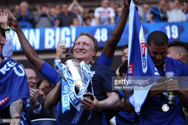 Cardiff City manager Neil Warnock celebrates as he holds the trophy during the Sky Bet Championship match between Cardiff City and Reading at Cardiff...