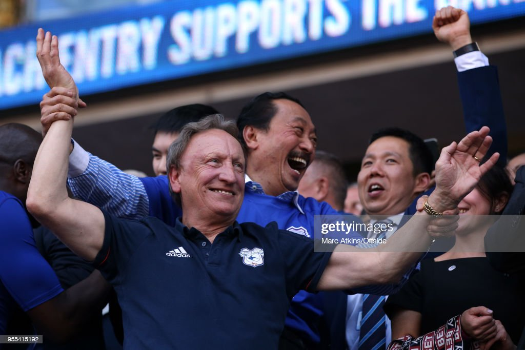 Cardiff City manager Neil Warnock celebrates with club owner Vincent Tan during the Sky Bet Championship match between Cardiff City and Reading at Cardiff City Stadium on May 6, 2018 in Cardiff, Wales.