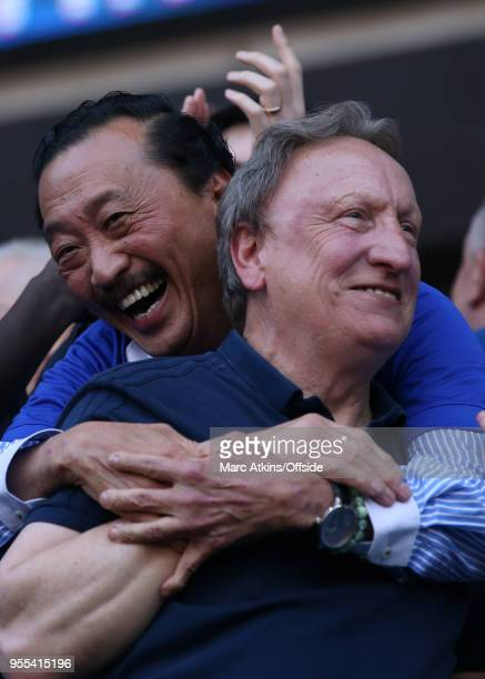 Cardiff City manager Neil Warnock celebrates with club owner Vincent Tan during the Sky Bet Championship match between Cardiff City and Reading at...