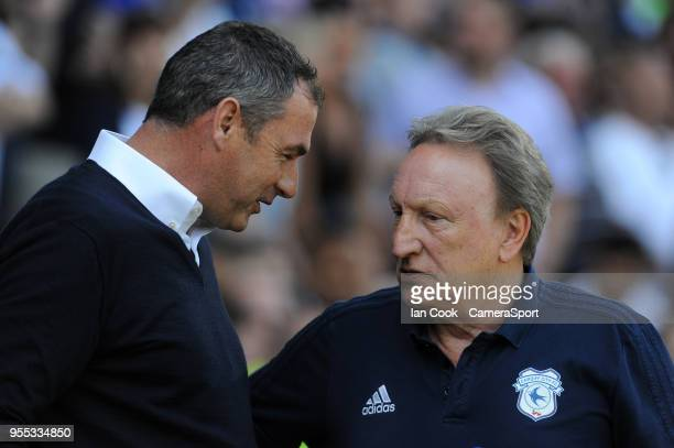 Cardiff City manager Neil Warnock chats to Reading manager Paul Clement during the Sky Bet Championship match between Cardiff City and Reading at...