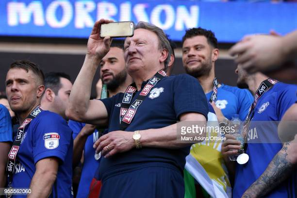 Cardiff City manager Neil Warnock films the celebrations on his mobile phone during the Sky Bet Championship match between Cardiff City and Reading...