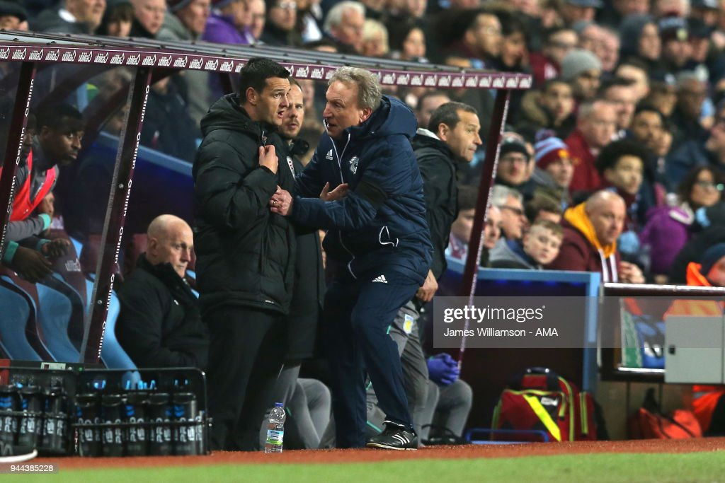 Cardiff City Manager Neil Warnock grabs Fourth Official Andrew Madley during the Premier League match between Leicester City and Newcastle United at The King Power Stadium on April 7, 2018 in Leicester, England.