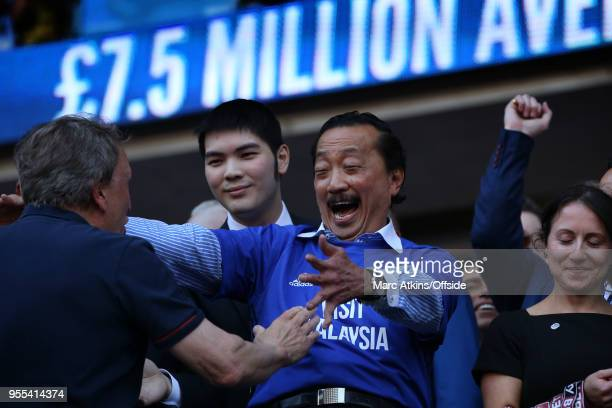 Cardiff City manager Neil Warnock is embraced by club owner Vincent Tan during the Sky Bet Championship match between Cardiff City and Reading at...