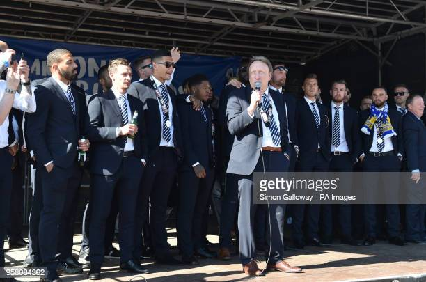 Cardiff City manager Neil Warnock speaks to the crowd during the promotion parade at Cardiff Castle Cardiff