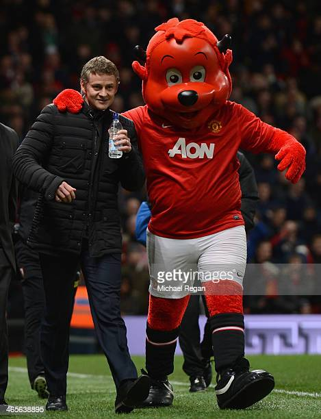 Cardiff City Manager Ole Gunnar Solskjaer is greeted by mascot Fred the Red prior to the Barclays Premier League match between Manchester United and...