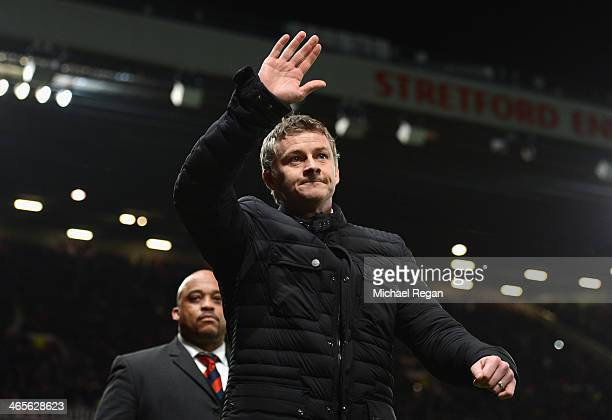 Cardiff City Manager Ole Gunnar Solskjaer salutes the crowd prior to the Barclays Premier League match between Manchester United and Cardiff City at...