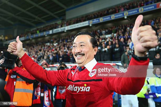 Cardiff City owner Vincent Tan celebrates his team's promotion to the Premier League at the end of the npower Championship match between Cardiff City...