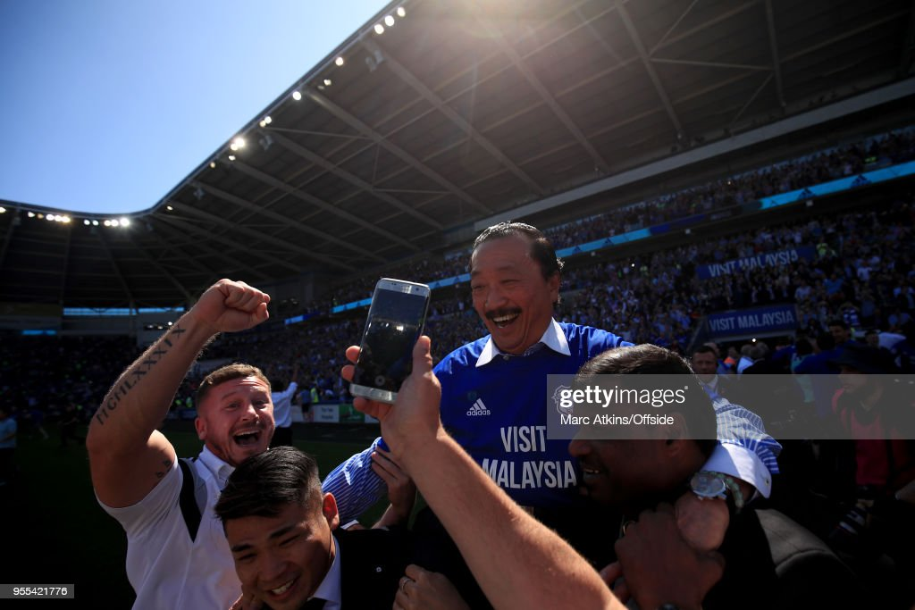 Cardiff City owner Vincent Tan is carried by the fans in celebration during the Sky Bet Championship match between Cardiff City and Reading at Cardiff City Stadium on May 6, 2018 in Cardiff, Wales.