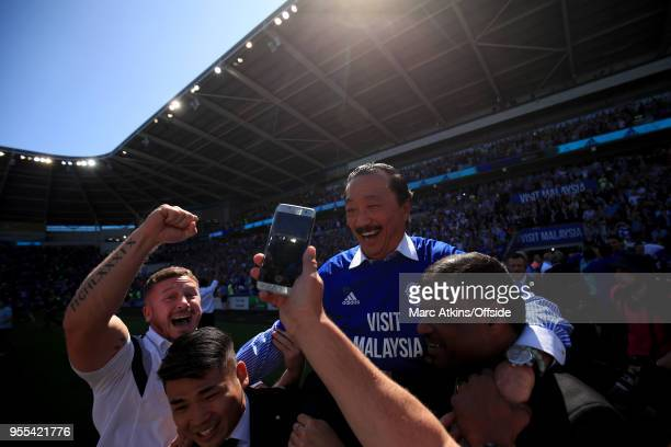 Cardiff City owner Vincent Tan is carried by the fans in celebration during the Sky Bet Championship match between Cardiff City and Reading at...