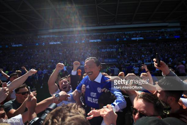 Cardiff City owner Vincent Tan is carried off by fans during the celebrations during the Sky Bet Championship match between Cardiff City and Reading...