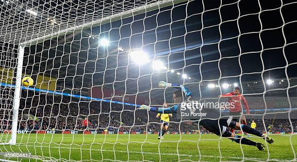 Cardiff City player Fraizer Campbell scores the second goal past Sunderland keeper Vito Mannone during the Barclays Premier League match between...