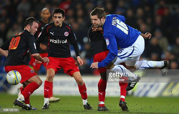 Cardiff City player Jon Parkin is brought down during the npower Championship match between Cardiff City and Reading at Cardiff City Stadium on...