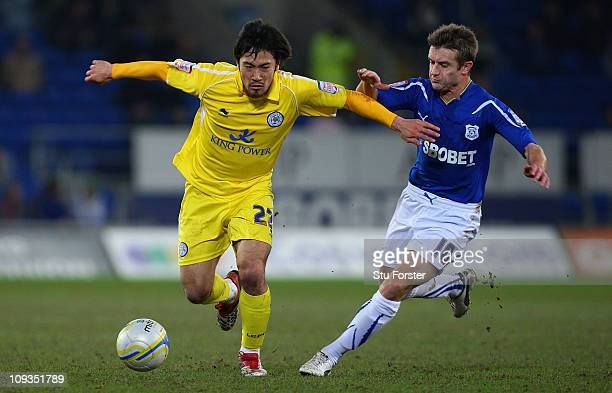 Cardiff City player Stephen Mcphail battles for the ball with Yuki Abe of Leicester City during the npower Championship match between Cardiff City...