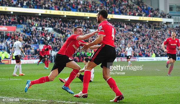 Cardiff City player Steven Caulker celebrates after scoring the opening goal with Craig Noone during the Barclays Premier league match between...