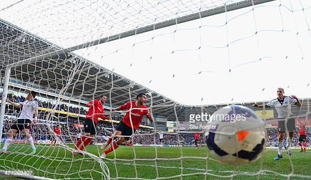 Cardiff City player Steven Caulker celebrates after scoring the opening goal during the Barclays Premier league match between Cardiff City and Fulham...